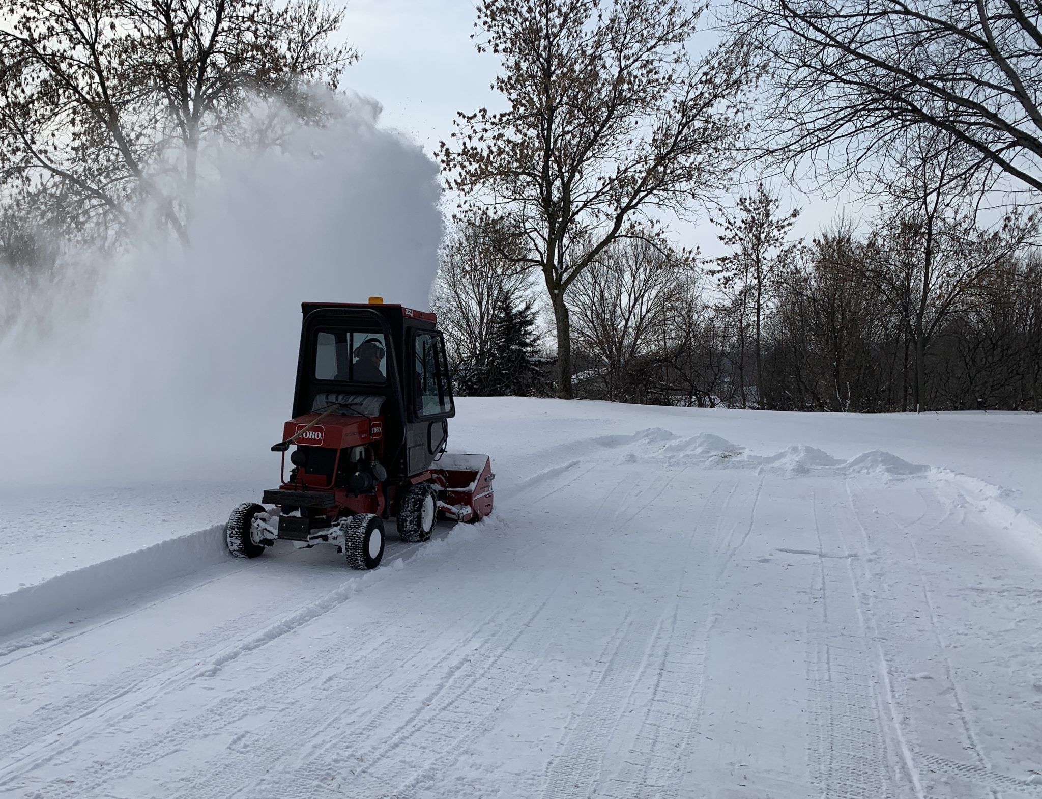Island View Golf Club removing snow from greens