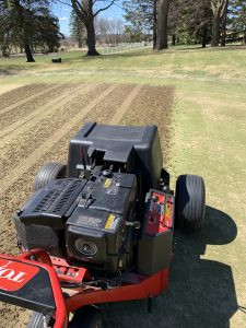 Core aerifying #2 green as part of the overseeding process.