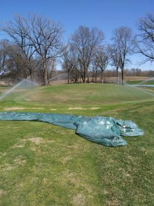 Watering after overseeding process was complete on #16 green.